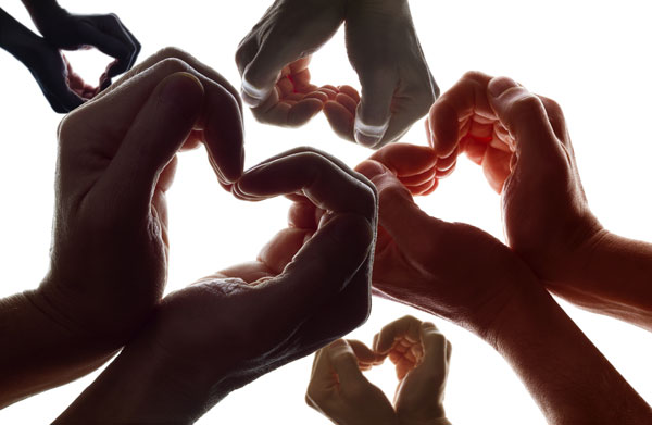 hands in heart shapes